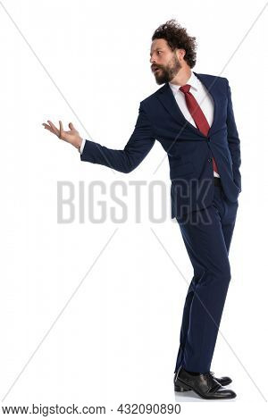 businessman turning back and arguing with someone against white background