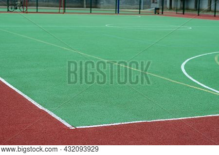 An Empty Soccer Field On A Sports Field. Field For Sports Games With A Coating Of Crumb Rubber. Spor