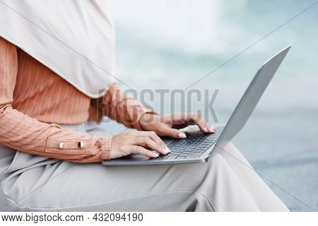 Millennial Unrecognizable Arabian Businesswoman Or Student Typing On Laptop, Chatting Online