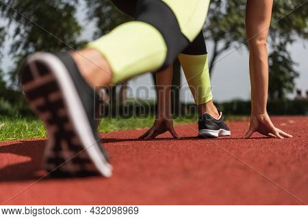 Partial View Of Sportswoman In Starting Pose On Stadium