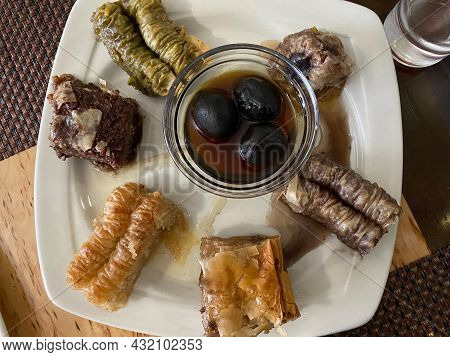 Oriental Sweets On White Plate In Cafe. Middle Eastern Dessert