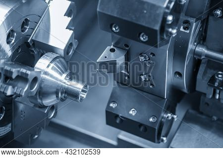 The  Cnc Lathe Machine Thread Cutting At The End Metal Cone Shape Parts. The Hi-technology Metal Wor