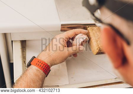 Hands Of A Professional Moulding The Pieces With Wax In A Dental Laboratory Specialised In Dental Bo