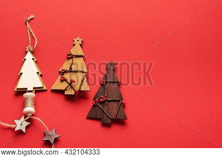 Old Christmas Objects Wooden Fir Tree And Red Cord, Snowflakes On Red Background. Christmas Banner.