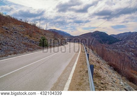 Balkan Road Trip.  Beautiful Overcast Landscape With Road In Dinaric Alps Mountains. Bosnia And Herz