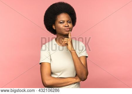 Unsure Pensive Young African American Student Woman Touching Her Chin, Frowning, Pondering, Look At