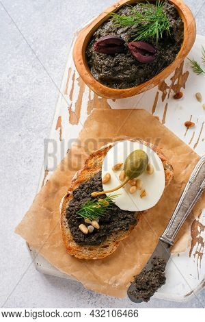 Sandwich With Slice Of Mozzarella Cheese And Tapenade, Caper On Light Grey Rustic Table Background.