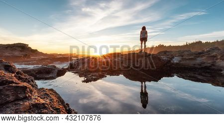 Adventurous Woman Hiking At Botanical Beach On The West Coast Of Pacific Ocean. Summer Sunny Sunset.
