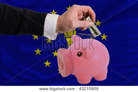 Dollar Into Piggy Rich Bank And  Flag Of American State Of Indiana