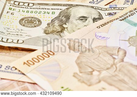 Us Dollar Banknote And Uzbek Sums. Concept Of Exchange Rate, Uzbek Sum To Us Dollar. Money Exchange