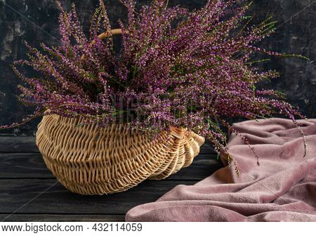 Basket With Flowers On A Black Background, Lilac Heather