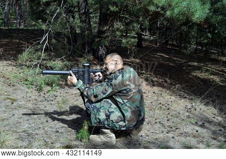 Mature man with KRISS Vector 9*21 caliber submachine gun in the forest. Unformal shooting range near Kiev. September 6,2021. Kiev Region, Ukraine
