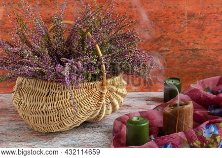 Basket With Flowers On A Red And White Background, Lilac Heather And Atmospheric Candles