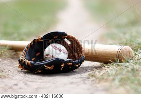 Baseball Ball With Glove And Bat On Nature