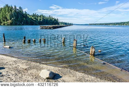 A View  Of A Derelict Pier In The Woodard Bay Conservation Area In Olympia, Washington.