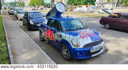Kiyv, Ukraine - August 2, 2020: Small Car Covered With The Red Bull Advertisement