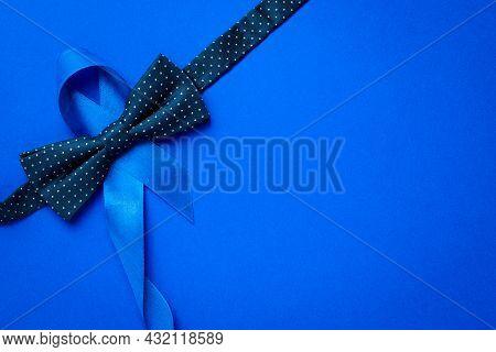 Prostate Awareness. Blue Ribbon, Fashion Bowtie Isolated On Deep Blue Background. Awareness Prostate