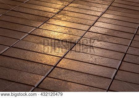 Golden Light On A Terracotta Tiled Floor