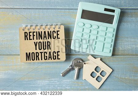 Refinance Your Mortgage Words On Tag With Dollar Note And Calculator On Wood Backgroud, Finance Conc