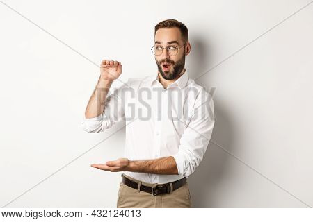 Amazed Businessman Showing Big Object, Describe Something Large And Looking Excited, Standing Over W
