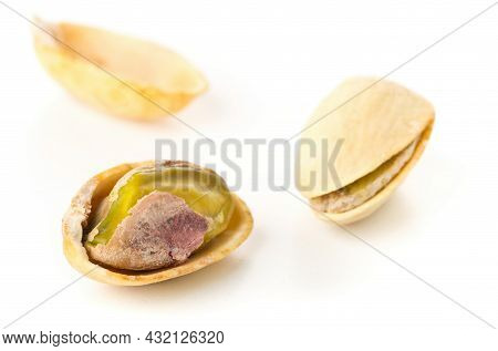 Macro Of Single Salted, Roasted Green Pistachio Nut Over White Background, Healthy Food Snack, Selec