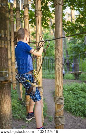 Safety Equipment In The Forest Adventure Park. The Use Of Equipment For Mountaineering: Carabiner, B