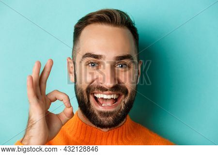 Close-up Of Confident And Happy Man With Beard Showing Okay Sign, Approve And Like, Giving Positive