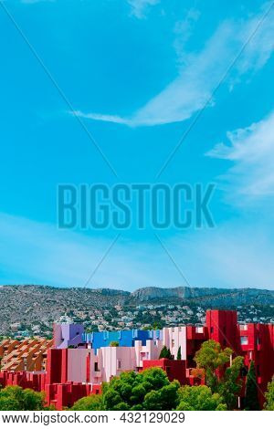Calpe, Spain - August 2, 2021: A view of the colorful La Muralla Roja building, in Calpe, Spain, an apartment building designed by Ricardo Bofill and built in 1972