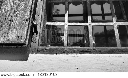 The Old Wooden Shutters Are Open. Old Rural Style. Lattices On The Windows. Summer, Heat. White Conc