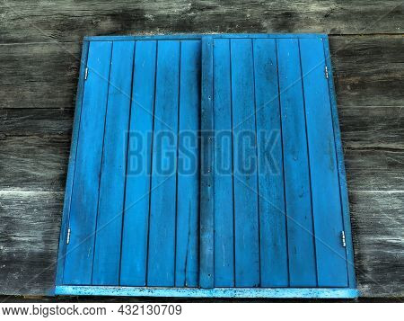Wooden Blue Closed Shutters On The Window Of An Old Traditional Staviany Village House. Old Ethno-ru