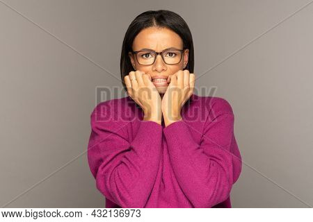 Frightened African American Female Holding Folded Hands Together Look Scared And Shocked. Desperate