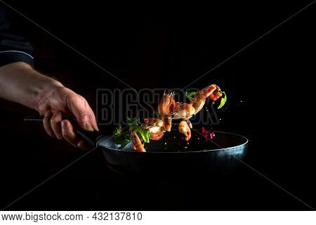 The Chef Cooks Shrimp In A Pan With Vegetables. Cooking Seafood, Healthy Vegetarian Food And Food On