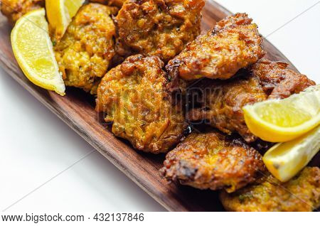 Delicious Onion Bhaji Fritters Served On Wooden Plate As A Starter, Anglo-indian Cuisine