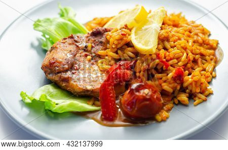 Spicy Chicken Breast And Long Grain Rice With Red Peppers, Tomatoes And Jalapeno Chillies