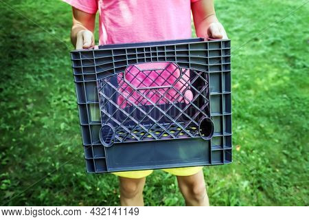 Teen boy holding a milk crate for the social media milk crate challenge