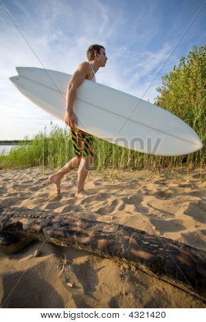 Surfer And His Board