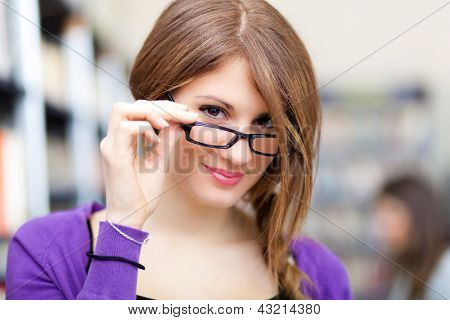 Beautiful female student portrait wearing eyeglasses