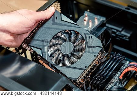Installing A Video Card On The Motherboard. Installing Computer Components In A Open Pc Case. Diy Pc