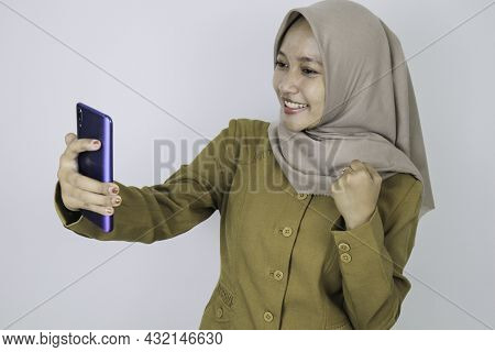 Smile Government Worker Women When Video Call Using A Smartphone. Pns Wearing Khaki Uniform.