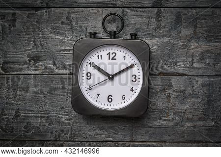 A Black Watch With A White Dial On A Wooden Background. Crassic Dial.