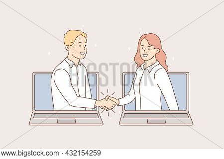 Online Meeting And Videoconference Concept. Young Smiling Business People Shaking Hands From Laptops