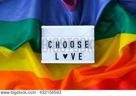 Rainbow Flag With Lightbox And Text Choose Love. Rainbow Lgbtq Flag Made From Silk Material. Symbol