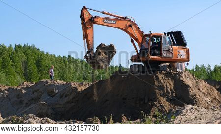 Yellow Excavator Carries Out Excavation Of Sand Digging At Construction Site: Moscow, Russia - Augus