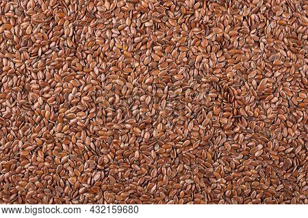Flax Seeds Background Top View. Flax Linen Seeds Texture. Food Background.