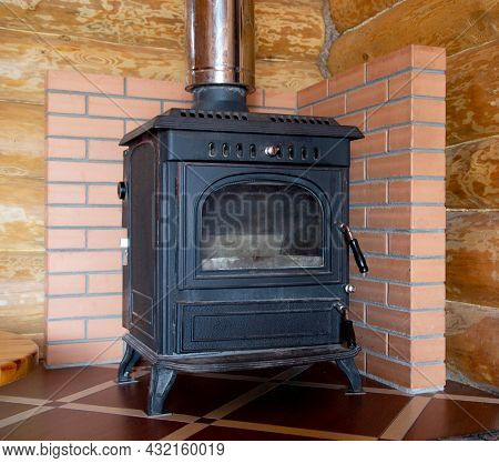 Cast Iron Fireplace Stove For Heating A Country House With Increased Thermal Conductivity, Close-up