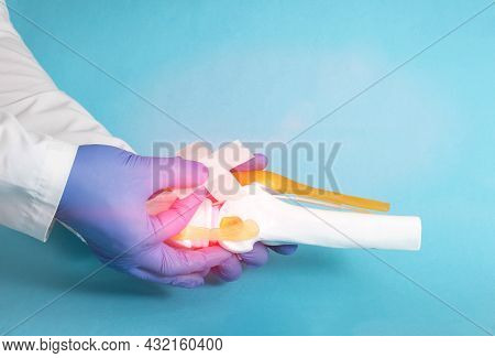 Doctor Traumatologist Orthopedist Glues A Medical Plaster On The Knee Joint Mockup On A Blue Backgro