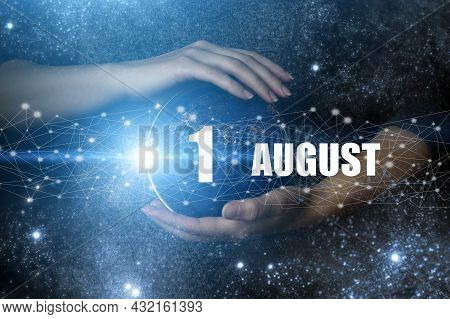 August 1st . Day 1 Of Month, Calendar Date. Human Holding In Hands Earth Globe Planet With Calendar