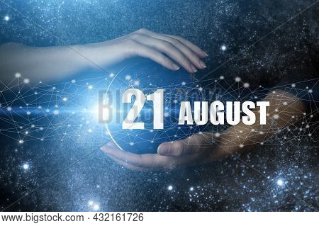 August 21st . Day 21 Of Month, Calendar Date. Human Holding In Hands Earth Globe Planet With Calenda
