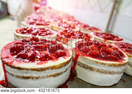 Making A Delicious And Beautiful Dessert Cake With Fresh Strawberries And Filled With Syrup. Confect