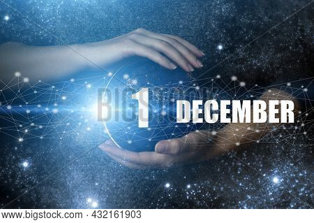 December 1st . Day 1 Of Month, Calendar Date. Human Holding In Hands Earth Globe Planet With Calenda